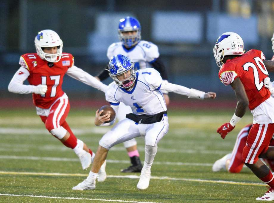Quarterback Colin Wilson running with the ball during Ludlowe's game against Greenwich.