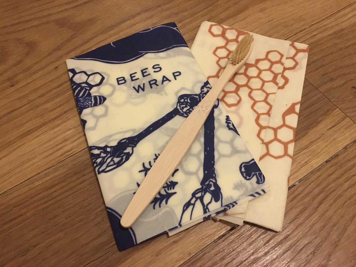Beeswax wrap and bamboo toothbrushes are sustainable, environmental-friendly products that help reduce plastic consumption.