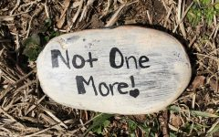 A rock found in a Fairfield open space communicates the message that violence against women must stop.