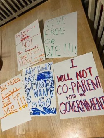 Families protesting the removal of religious exemptions for vaccines marched to the State capitol on April 27 with signs reading, Live free or die!
